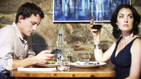 Is it okay to use smartphone when having a meal with someone?